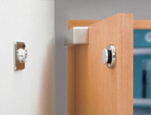 magnetically held fire door